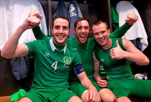 Republic of Ireland's, from left, John O'Shea, Richard Keogh and Glenn Whelan celebrate in the dressingroom after the game. UEFA EURO 2016 Championship Qualifier, Play-off, 2nd Leg, Republic of Ireland v Bosnia and Herzegovina. Aviva Stadium, Lansdowne Road, Dublin. Picture credit: David Maher / SPORTSFILE