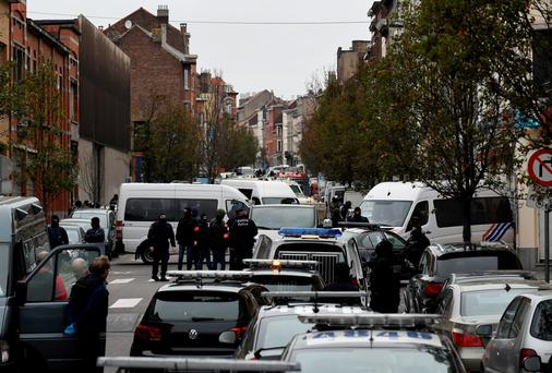 Police prepare to raid a house in the Molenbeek area of Brussels
