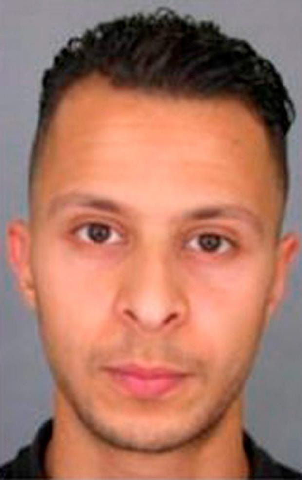This undated file photo provided by French Police shows 26-year old Salah Abdeslam, who is wanted by police in connection with recent terror attacks in Paris, as police investigations continue Friday, Nov. 13, 2015. French police released the wanted notice and photo of the suspect on the run since the attacks in Paris on Friday. The notice, released on the France National Police Twitter account, says anyone seeing Salah Abdeslam, should consider him dangerous. (Police Nationale via AP)
