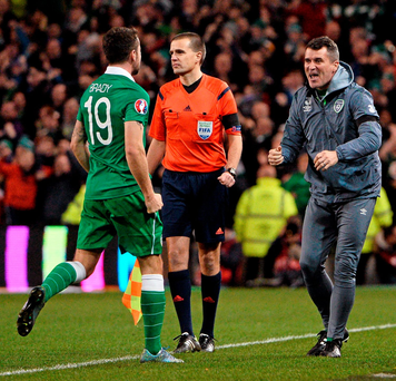 Republic of Ireland assistant manager Roy Keane celebrates with Robbie Brady after Jonathan Walters scored his side's second goal