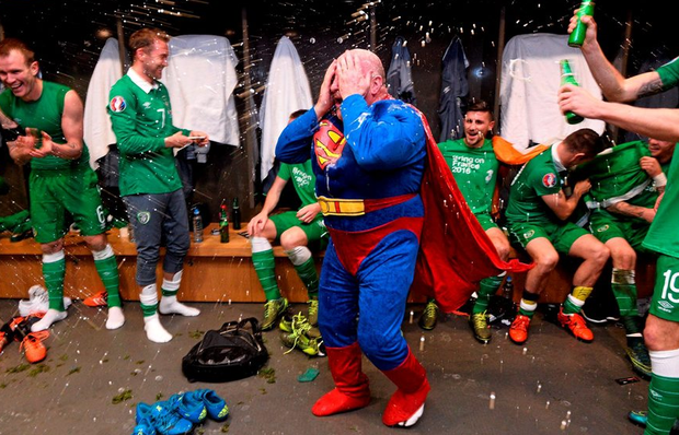 Republic of Ireland equipment officer Dick Redmond and players celebrate in the dressingroom after the game.