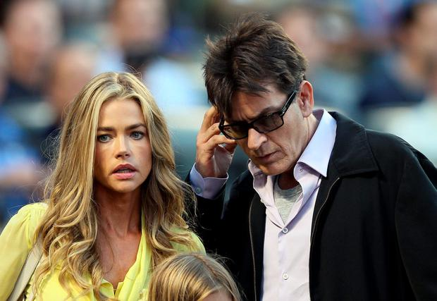 Denise Richards and Charlie Sheen look for their seats as the New York Yankees take on the New York Mets on June 23, 2012 during interleague play at Citi Field in the Flushing neighborhood of the Queens borough of New York City. (Photo by Elsa/Getty Images)