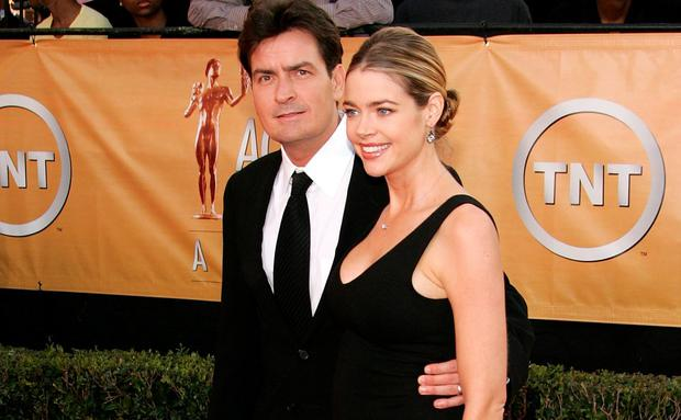 Actor Charlie Sheen and Denise Richards arrive at the 11th Annual Screen Actors Guild Awards at the Shrine Exposition Center on February 5, 2005 in Los Angeles, California. (Photo by Vince Bucci/Getty Images)
