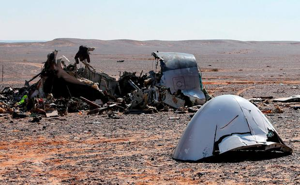 The debris from a Russian airliner is seen at its crash site at the Hassana area in Arish city, north Egypt, November 1, 2015. Egyptian authorities have detained two employees of Sharm al-Sheikh airport in connection with the downing of a Russian jet on October 31, killing all 224 people on board, two security officials said on November 17, 2015