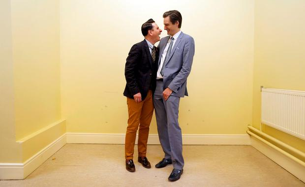 Richard Dowlin (L), 35, and Cormac Gollogly, 35, smile after being married by registrar Mary Claire Heffernan in the South Clonmel Community Care Centre Credit: Cathal McNaughton (REUTERS)