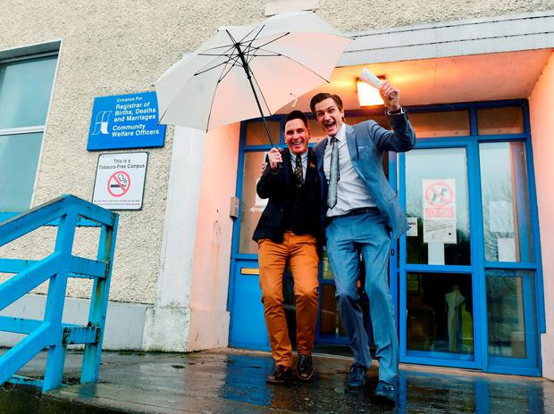 Richard Dowlin (L), 35, and Cormac Gollogly, 35, smile after being married in Tipperary Credit: Cathal McNaughton (REUTERS)