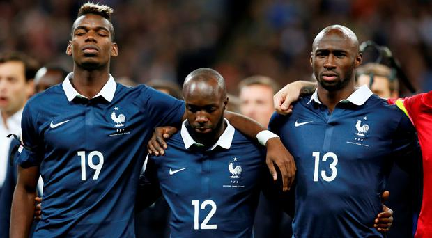 Paul Pogba, Lassana Diarra and Eliaquim Mangala line up before the game Action Images via Reuters / John Sibley