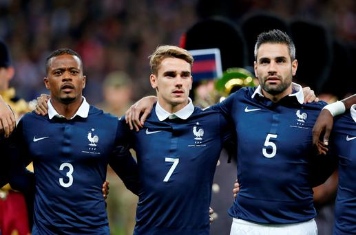 Patrice Evra, Antoine Griezmann and Loic Perrin line up before the game Action Images via Reuters / John Sibley Livepic EDITORIAL USE ONLY.