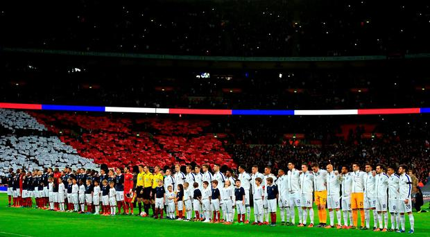England and France sign the national anthems prior to the international friendly match at Wembley on Tuesday