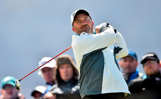 Damien McGrane moved into the card places with two rounds to go in the European Tour Qualifying School at PGA Catalunya Resort