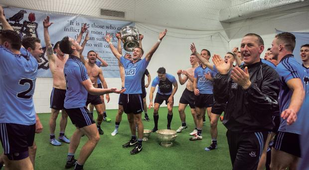 20 September 2015; The shackles are off. Wonderful, chaotic scenes in the Dublin dressingroom as the players let their hair down after a year of outstanding achievement - and sacrafice. Picture credit: Ray McManus / SPORTSFILE This image may be reproduced free of charge when used in conjunction with a review of the book