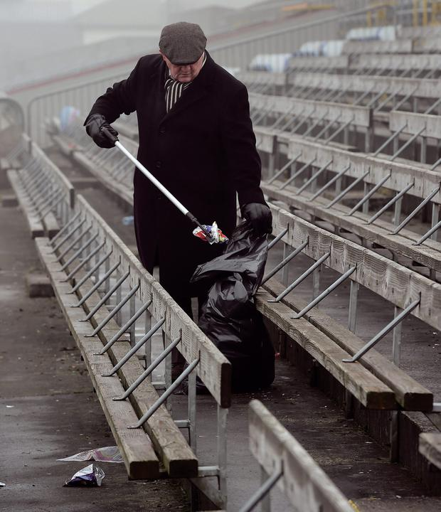 8 February 2015; A clean sweep, Cusack Park steward Séamus McLoughlin, from Moate, tidies the ground before the Westmeath-Galway league game. Picture credit: Ray McManus / SPORTSFILE This image may be reproduced free of charge when used in conjunction with a review of the book