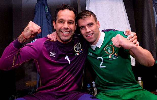 David Forde and Seamus Coleman celebrate after beating Bosnia