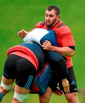 James Cronin feels the impact of a tackle during Munster training yesterday