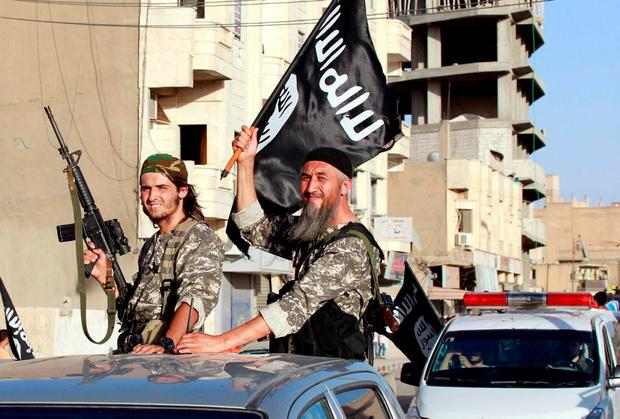 Isil fighters in Raqqa, Syria, last year. 'Isil hates the West simply because we don't share their religion'