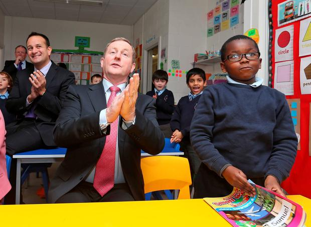 Taoiseach Enda Kenny and Minister Leo Varadkar with Samuel Ogunbe (6) at Scoil Bride, Blanchardstown, where they launched the school building programme. Photo: Colin Keegan