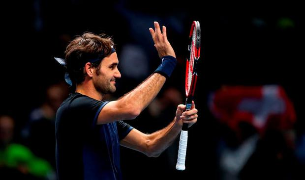 Roger Federer celebrates defeating Novak Djokovic in straight sets during day three of the ATP World Tour Finals at the O2 Arena, London.