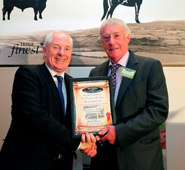 Brendan McFeely receiving the 2015 Irish Charolais Cattle Society scroll of honour from Minister of State, Michael Ring TD.