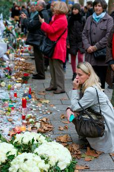 Mourners pay their respects in Paris. Photo: Mark Condren