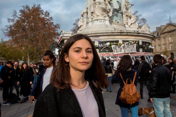 Local woman Malou in front of the monument in the Place de la République in Paris.