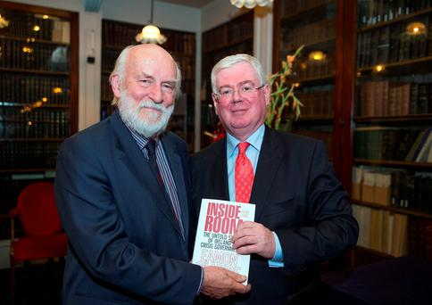 Eamon Gilmore with former Press Ombudsman John Horgan at the launch of his book 'Inside the Room' at the Royal Irish Academy, Dublin. Photo: Arthur Carron