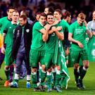 Republic of Ireland's Robbie Brady (C) gets a hug from Seamus Coleman after the match