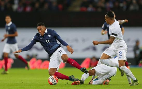 Anthony Martial hits the turf under an English challenge at Wembley
