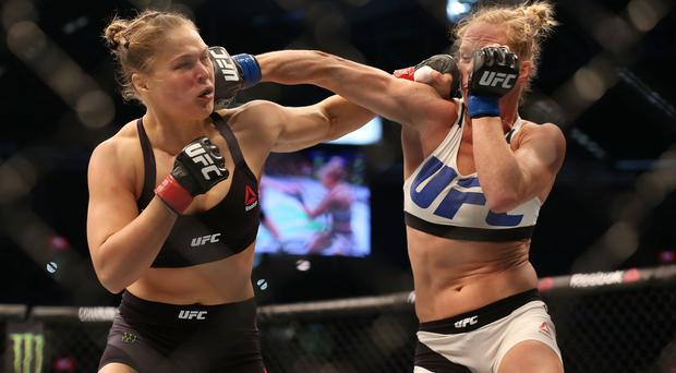 MELBOURNE, AUSTRALIA - NOVEMBER 15: Ronda Rousey of the United States (L) and Holly Holm of the United States compete in their UFC women's bantamweight championship bout during the UFC 193 event at Etihad Stadium on November 15, 2015 in Melbourne, Australia. (Photo by Quinn Rooney/Getty Images)