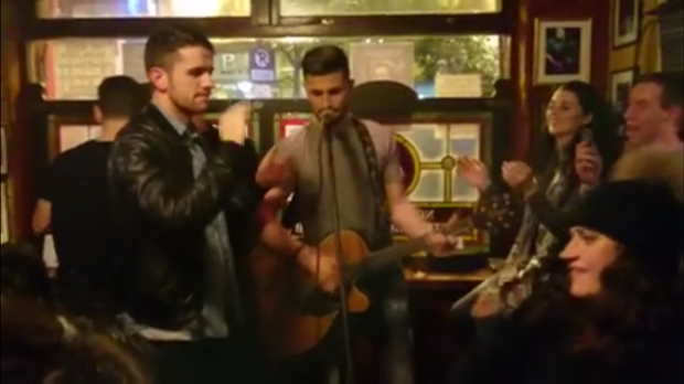 Ireland internationals Robbie Brady and Shane Long singing in Temple Bar, Dublin.