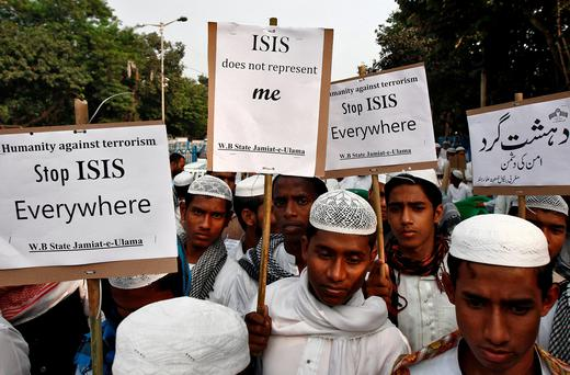 Activists from a Muslim group hold placards during a protest rally against the Paris attacks, in Kolkata, India, November 18, 2015. Reuters/Rupak De Chowdhuri