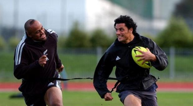 Jonah Lomu and Doug Howlett in action during New Zealand training