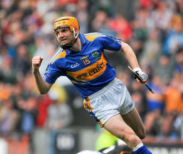 Tipperary's Lar Corbett, here celebrating the second of his three goals against Kilkenny in the 2010 All-Ireland SHC final, has announced his retirement