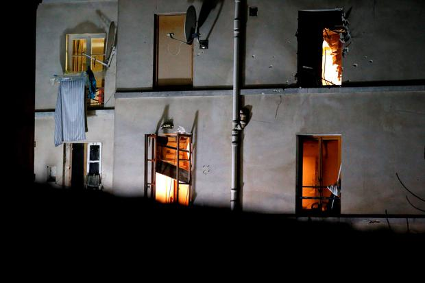 Bullet holes and smashed windows are pictured on the back side of the house after an intervention of security forces against a group of extremists in Saint-Denis, near Paris, Wednesday, Nov. 18, 2015. (AP Photo/Michel Euler)