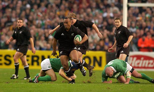Jonah Lomu charges through the Irish defence during the 2001 Test match at Lansdowne Road