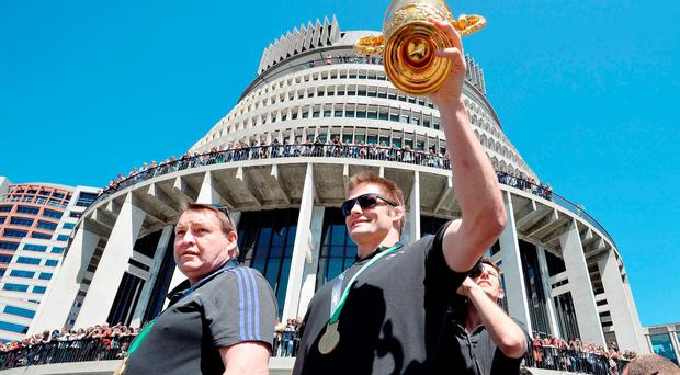 New Zealand All Blacks Captain Richie McCaw (right) holds the Rugby World Cup Trophy November 6, 2015. John Stillwell/PA Wire