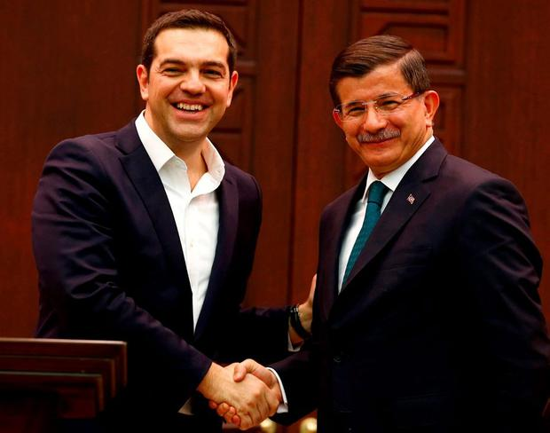 Turkish prime Mmnister Ahmet Davutoglu (right) shakes hands with Greek counterpart Alexis Tsipras in Ankara