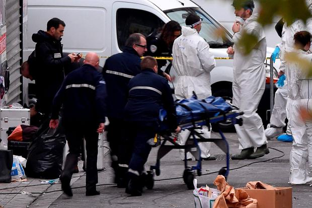 A body is removed from the apartment raided by French Police special forces earlier in the northern Paris suburb of Saint-Denis