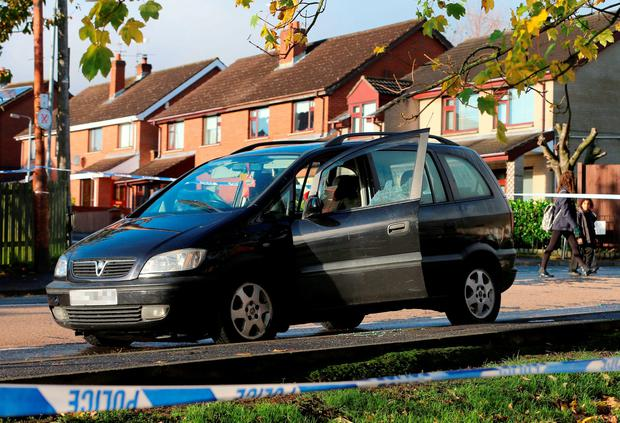 The scene in Shaws Road, west Belfast, after a man was shot in the head.