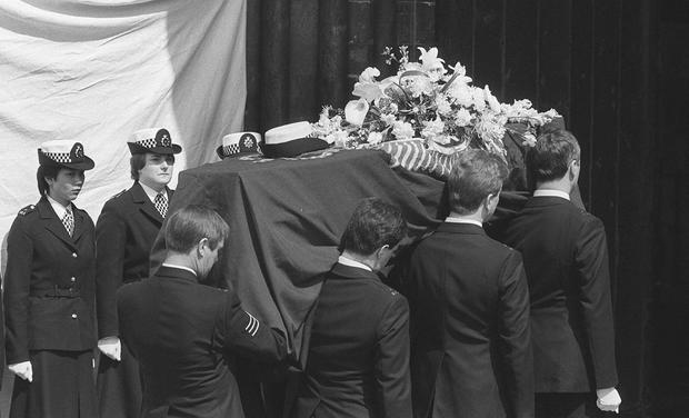 File photo dated 27/04/84 of a honour guard of Pc's as the coffin of Pc Yvonne Fletcher is borne into Salisbury Cathedral, as a was arrested on suspicion of conspiring to murder the Pc, who was shot dead outside the Libyan embassy in London 31 years ago