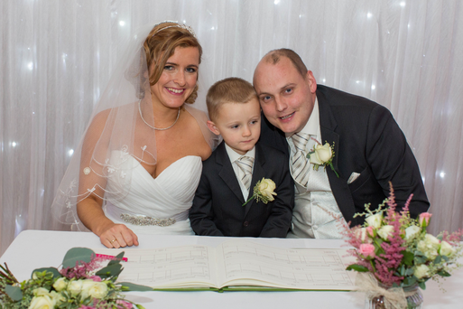 David Smith (34) and Katy Harris with their son Danny on their wedding day.