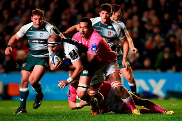 Leicester Tigers' Lachlan McCaffrey (second left) is tackled by Stade Francais' Patrick Sio during the Champions Cup, pool four match at Welford Road, Leicester