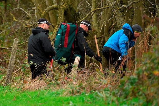 Police make their way across a field in Ibstock, Leicestershire, near to where a body has been found during the search for missing Kayleigh Haywood. Joe Giddens/PA Wire
