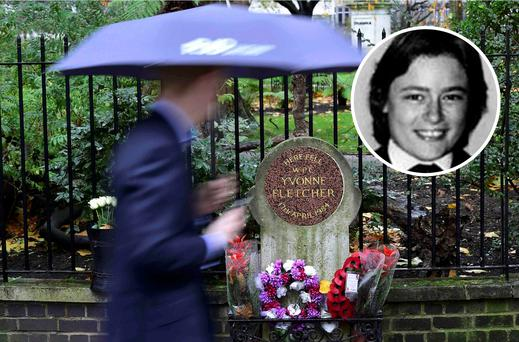Floral tributes left at the memorial plaque for police constable Yvonne Fletcher (inset) at St James's Square in London