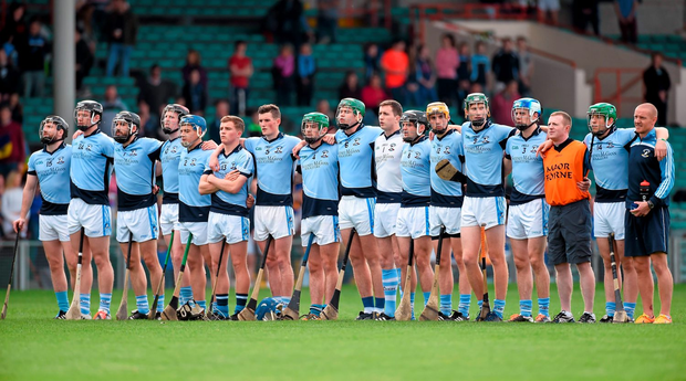 Na Piarsaigh players gather together for the national anthem before this year's Limerick county hurling final against Patrickswell