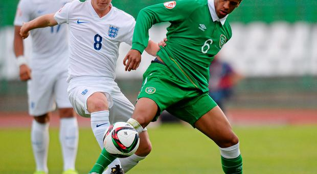 Marcus Agyei-Tabi in action for Ireland against Daniel Wright, England