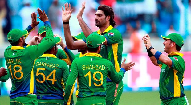 Pakistan's bowler Mohammed Irfan, center, celebrates the wicket of England batsman AD Hales, not pictured, during the Pakistan and England 4th One Day International match at the Dubai International Stadium in Dubai