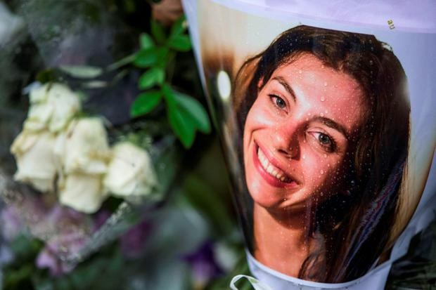 Raindrops fall on a photograph of one of the victims of the Bataclan attack in Paris places across the road from the theatre. Pic:Mark Condren