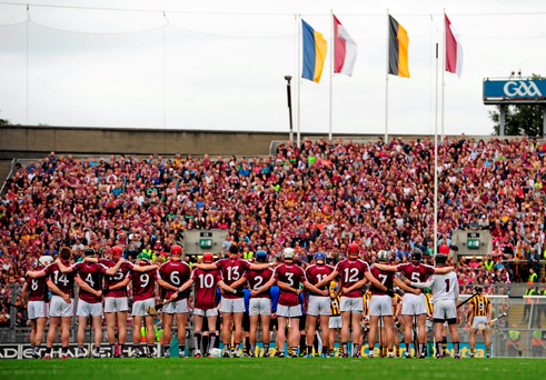 The Galway hurlers stand for the national anthem before this year's All-Ireland final