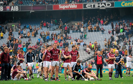 Galway's defeated players on the field after losing to Kilkenny in this year's All-Ireland SHC final
