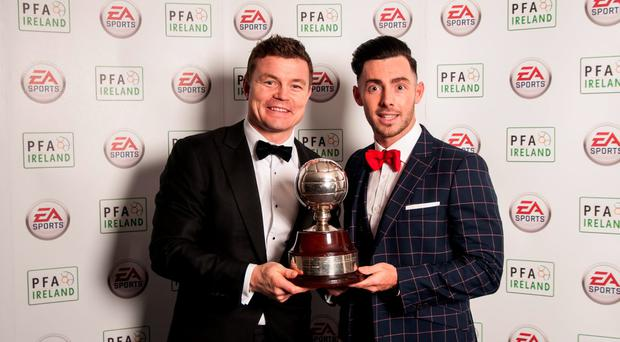 Guest of Honour Brian O'Driscoll presents Richie Towell with his PFAI Player of the Year Award